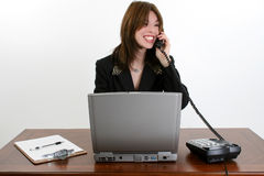 Beautiful Hispanic Woman at Desk Stock Photography