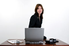 Beautiful Hispanic Woman at Desk Royalty Free Stock Photo