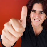 Beautiful hispanic woman doing the thumbs up sign Royalty Free Stock Image