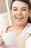 Beautiful Hispanic Woman Drinking Tea or Coffee Stock Photography