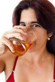 Beautiful hispanic woman drinking whisky Stock Photos