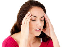 Beautiful hispanic woman having a headache. Against a white background Royalty Free Stock Photography