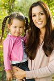 Beautiful Hispanic woman with her daughter. Portrait of a Hispanic mother and her daughter Royalty Free Stock Photos