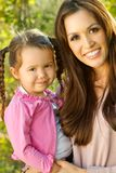 Beautiful Hispanic woman with her daughter. Portrait of a Hispanic mother and her daughter Royalty Free Stock Images