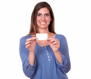 Beautiful hispanic woman holding blank card Royalty Free Stock Photos