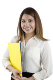 Beautiful Hispanic Woman Holding Folders. A smiling latino woman with folders stock photo