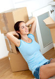 Beautiful hispanic woman relaxing between boxes Royalty Free Stock Images