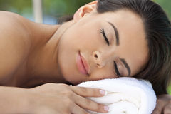 Beautiful Hispanic Woman Relaxing At Health Spa Royalty Free Stock Photography