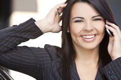 Beautiful Hispanic Woman Using Cell Phone Royalty Free Stock Images