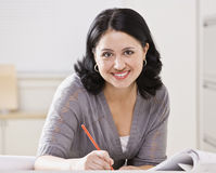 Beautiful Hispanic Woman Writing Royalty Free Stock Images