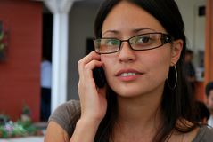 Beautiful Hispanic women on the phone. A beautiful Hispanic woman talks on her cell phone Stock Photos
