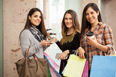 Beautiful Hispanic women at a shopping center. Portrait of a group of three gorgeous Hispanic women doing some shopping and hanging out at a mall Stock Image