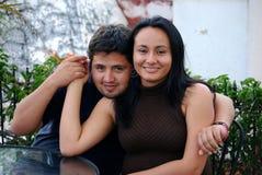 Beautiful Hispanic young couple. Beautiful Hispanic couple embracing in an outdoor setting Stock Image