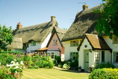Beautiful historic thatched cottages. Beautiful historic thatched cottages including listed forge cottage in Pulham Market, Norfolk, England Royalty Free Stock Image