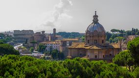 Beautiful historical landmarks and architecture of Rome: Colosseum, Basilica, ancient ruins of the Forum Caesar, Temple of Peace royalty free stock images
