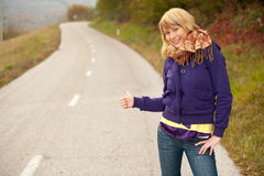 Beautiful hitchhiker Stock Images