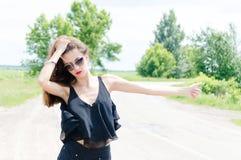 Beautiful hitchhiker royalty free stock photography