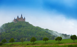 Beautiful Hohenzollern castle in haze at summer Royalty Free Stock Photography