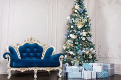Beautiful holdiay decorated room with Christmas tree with presents under it Royalty Free Stock Images