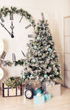 Beautiful holdiay decorated room with Christmas tree and presents under it Royalty Free Stock Photo