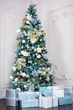 Beautiful holdiay decorated room with Christmas tree with presents under it Royalty Free Stock Photography