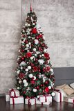 Beautiful holdiay decorated room with Christmas tree with presents under it Royalty Free Stock Image