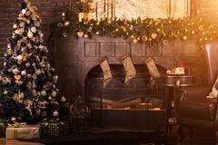 Beautiful holdiay decorated room. Christmas tree with presents under it stock photos
