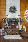 Cozy christmas interior with decorated fireplace Royalty Free Stock Photos