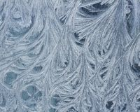 beautiful holiday background of intricate frosty pattern on glass stock image