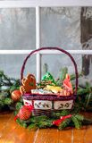 Holiday cookies on a winter background. Beautiful holiday basket of holiday cookies on a winter background with sprigs of fir garland Stock Photos