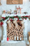 Beautiful holiday decorated room with Christmas tree, fireplace and with presents. Cozy winter scene. White interior. Room, Christmas Tree, Xmas Home Interior Royalty Free Stock Photo