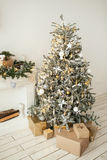 Beautiful holiday decorated room with Christmas tree with presen Stock Photo