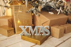 Beautiful holiday decorated room with Christmas tree with presents under it Stock Photos
