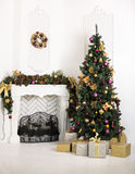 Beautiful holiday decorated room with fireplace and Christmas tr Stock Photos