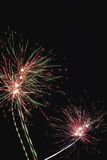 Beautiful holiday fireworks on the black sky Royalty Free Stock Photos