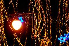 Beautiful holiday illumination. New Year decoration in a park. Beautiful holiday illumination close up Royalty Free Stock Photography