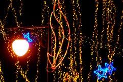 Beautiful holiday illumination. New Year decoration in a park. Beautiful holiday illumination close up Stock Photography