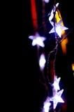 Beautiful holiday illumination. New Year decoration in a park. Beautiful holiday illumination close up. Neon background Stock Photography