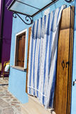 Beautiful home facade with Striped curtains in Burano island (Venice, Italy) Stock Images