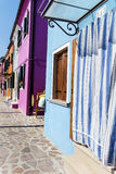 Beautiful home facade with Striped curtains in Burano island (Venice, Italy) Royalty Free Stock Photos