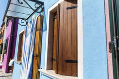 Beautiful home facade with Striped curtains in Burano island (Venice, Italy) Royalty Free Stock Image