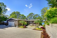 Beautiful home with garage, lake view and large front yard. Royalty Free Stock Photography