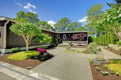 Beautiful home with garage, lake view and large front yard. Stock Image