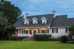 Beautiful home lit up at twilight stock photos