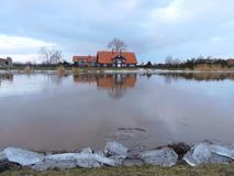 Home and river Minija in winter, Lithuania Royalty Free Stock Photography