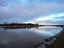 Home and river Minija in winter, Lithuania Stock Photography