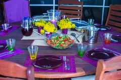 Beautiful home served table for dinner on the veranda Royalty Free Stock Image