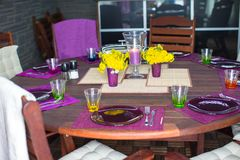 Beautiful home served table for dinner on the veranda Stock Photo