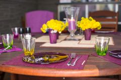 Beautiful home served table for dinner on the veranda Stock Photos