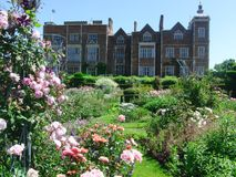 Beautiful Home. Stately Home And Rose Garden stock photo